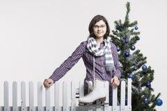 Moça com patins de gelo Imagens de Stock