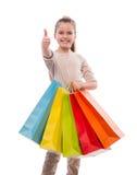 Moça com sacos de compras coloridos Imagens de Stock