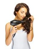 Moça com secador de cabelo Fotos de Stock