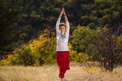 Moça contratada na ioga Imagem de Stock Royalty Free