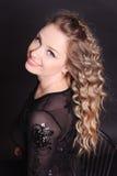 Moça de sorriso sobre o preto Imagens de Stock Royalty Free