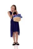 Moça e flores em uma cesta imagens de stock royalty free