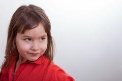 Moça em uma camisa vermelha fotos de stock royalty free