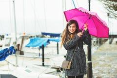 Moça feliz sob a chuva Imagens de Stock