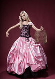 A moça gosta de uma boneca de Barbie Foto de Stock Royalty Free