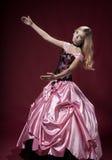 A moça gosta de uma boneca de Barbie Foto de Stock