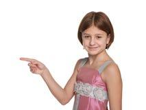 A moça mostra-lhe os dedos ao lado Imagem de Stock