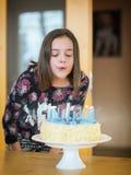 Moça na festa de anos Fotos de Stock