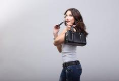 Moça nas calças de brim. Foto de Stock Royalty Free