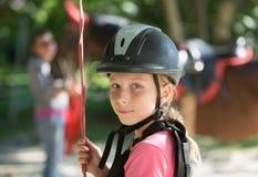 Moça no capacete do cavaleiro de horseback Foto de Stock Royalty Free