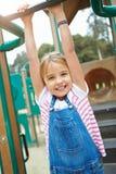 Moça no quadro de escalada no campo de jogos Fotografia de Stock Royalty Free