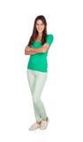 Moça ocasional com estar das calças de brim Imagem de Stock Royalty Free