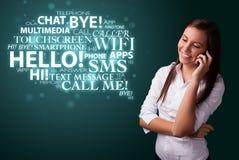 Moça que chama pelo telefone com nuvem da palavra Foto de Stock Royalty Free