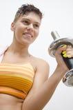 Moça que exercita com peso Imagem de Stock Royalty Free