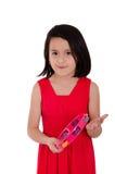 Moça que faz a música com pandeiro no branco Fotos de Stock Royalty Free