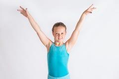 Moça que faz a saudação do gymastics Foto de Stock