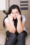 Moça que olha a tevê em casa Fotos de Stock Royalty Free