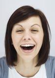 Moça que ri sinceramente Imagens de Stock Royalty Free