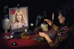 A moça tem o bate-papo video com bruxa moderna imagens de stock royalty free