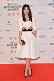 Moët British Independent Film Awards 2014. LONDON, ENGLAND - DECEMBER 07: Gemma Chan attends the Moet British Independent Film Awards 2014 at Old Billingsgate royalty free stock photos
