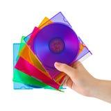 Mão com discos do computador Imagem de Stock