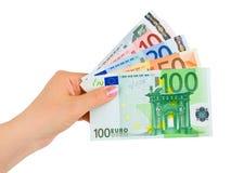 Mão com euro- dinheiro Fotografia de Stock Royalty Free