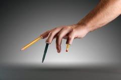Mão com pena e lápis em vez dos dedos Imagens de Stock Royalty Free
