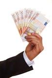 Mão com ventilador do dinheiro Fotos de Stock Royalty Free