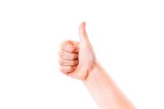 A mão da criança com polegar acima. Sinal da positividade Imagem de Stock