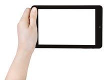 A mão da criança que mantém o PC da tabuleta isolado Imagens de Stock Royalty Free