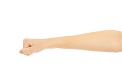 A mão da mulher com apertou um punho Imagens de Stock Royalty Free