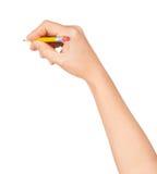 Mão da mulher com um lápis curto Imagens de Stock Royalty Free