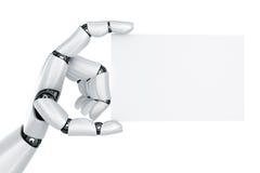Mão do robô que prende um sinal em branco Fotografia de Stock Royalty Free