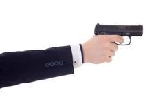 Mão masculina no terno de negócio que mantém a arma isolada no branco Fotografia de Stock