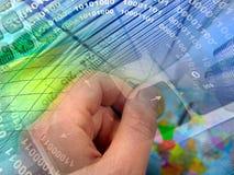 Mão, moeda e edifícios Imagem de Stock