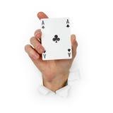 A mão prende o ás de clubes isolados no branco Imagem de Stock Royalty Free