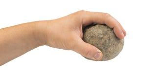 Mão que guarda a bola de pedra Fotos de Stock Royalty Free