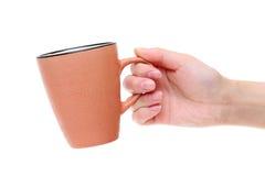 Mão que guarda o copo de café Fotografia de Stock