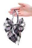 Mão que guarda o laço para a mulher Foto de Stock