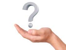 Mão que guarda o ponto de interrogação em um fundo branco Foto de Stock Royalty Free