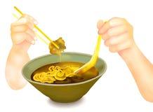 Mão que guardara Chopsticks para comer macarronetes de Ramen Fotografia de Stock Royalty Free