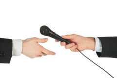 A mão toma o microfone de outro Imagem de Stock Royalty Free