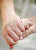 Mão velha e nova Fotografia de Stock Royalty Free