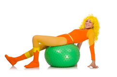 A moça com a bola suíça isolada no branco Foto de Stock Royalty Free