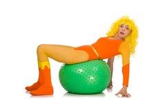 A moça com a bola suíça isolada no branco Imagens de Stock Royalty Free