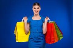 Moça com pacotes Imagem de Stock