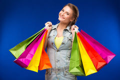 Moça com pacotes Fotografia de Stock Royalty Free