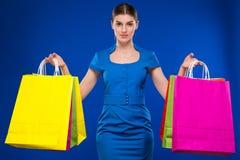 Moça com pacotes Imagens de Stock