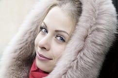 Moça em uma capa da pele Foto de Stock Royalty Free