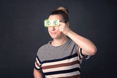 Moça que guarda de papel com sinal de dólar verde Fotografia de Stock